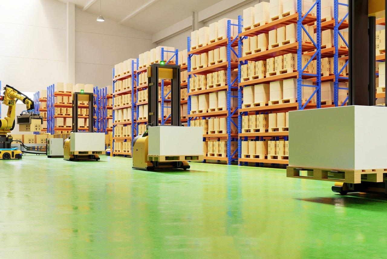 Alt : Des AGV déplacent des cartons